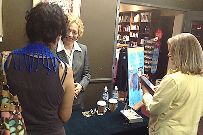 Sofia Wellman signs books at Agape International Spiritual Center founded by Michael Bernard Beckwith