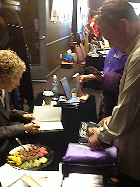 Sofia Wellman signs her book at Michael Bernard Beckwith's Agape International Spiritual Center
