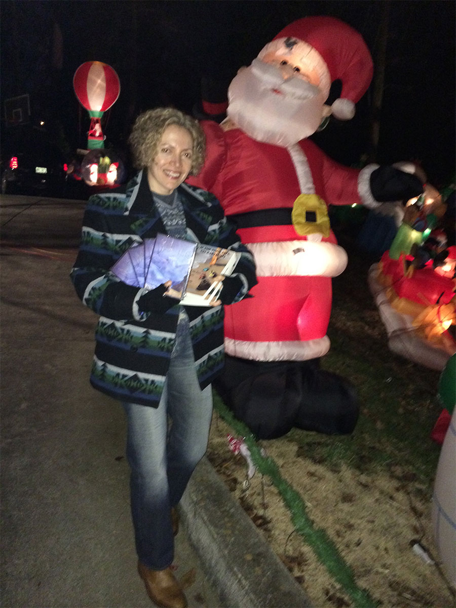 """Sofia Wellman hangs out with Santa Claus to encourage him to bring everyone her film """"Death As Life"""" and her book """"If The Shoe Fits, Go Barefoot"""""""