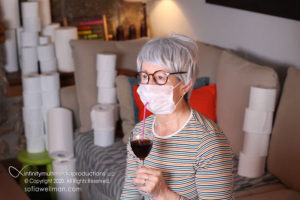 Sofia Wellman - A New Normal - Woman Wearing Mask Drinking Wine with Toilet Paper